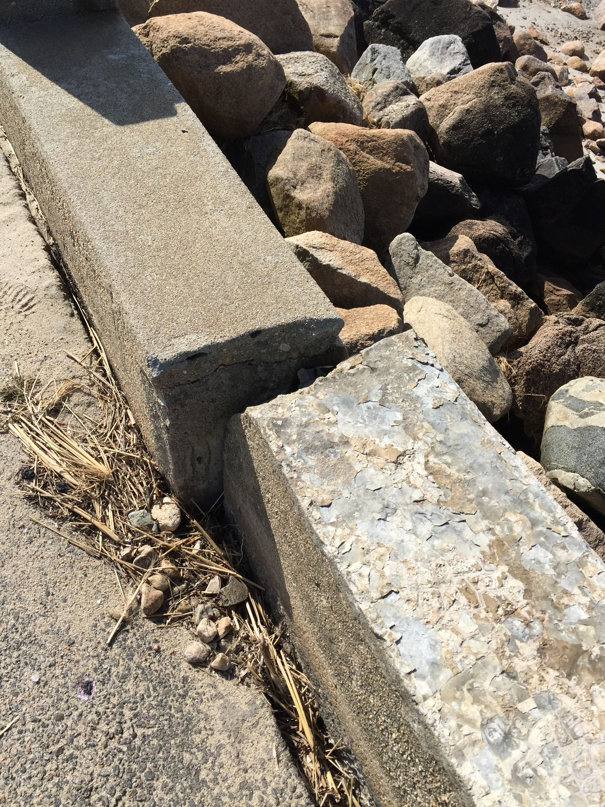 Photo of failing joint of seawall sections